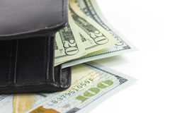 Closeup the dollars in wallet on white background Royalty Free Stock Photos