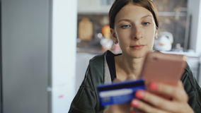 Closeup dolly shot of beautiful young woman have online banking and shopping using smartphone and credit card in the stock footage