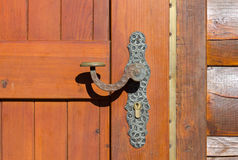Closeup on a Door Handle of a Mountain Cabin Exterior Stock Photo
