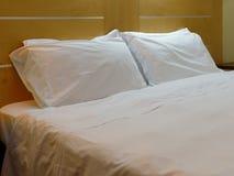 Closeup double bedroom modern room. Closeup pillows double bedroom modern style Royalty Free Stock Images