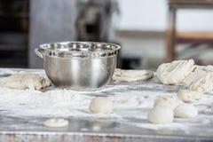 Closeup Of Dough Balls And Bowl On Table Stock Photos