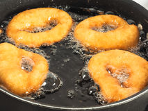 Closeup of doughnuts boiling Royalty Free Stock Photos