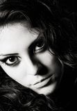 Closeup dramatic portrait of beautiful young girl. Black and white Stock Photography