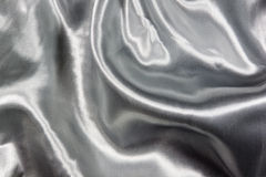 Closeup of Draped Soft Silver Satin Fabric Stock Photos