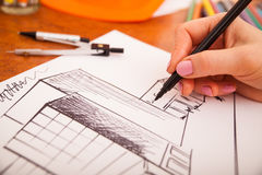 Closeup of drawing building at the desk Royalty Free Stock Photo