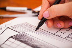 Closeup of drawing building at the desk Royalty Free Stock Photography