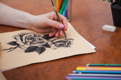 Closeup of drawing roses at the desk Stock Photo