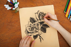Closeup of drawing roses at the desk Royalty Free Stock Photography
