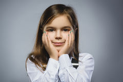Closeup dreaming Young girl Looking Up Against Gray Background Stock Photography