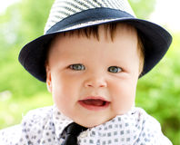 Closeup of dressed-up baby boy outdoor Stock Photos