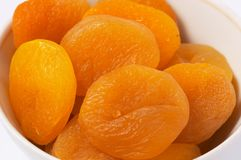 Closeup of dried apricots. On white background with light shadow royalty free stock photos
