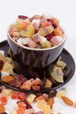 Closeup of dried fruits in a black cup Royalty Free Stock Image