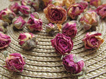 Closeup of dried roses on wicker rug background Royalty Free Stock Photography
