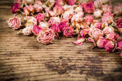 Closeup of dried roses on wooden background Stock Images