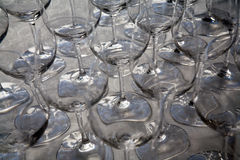 Closeup of drinking glasses. An abstract view of a collection of empty wine or drinking glasses Royalty Free Stock Photos