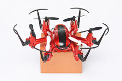 Closeup of drone with package box Stock Images