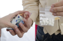 Closeup of drug trading with money and pills. Stock Images