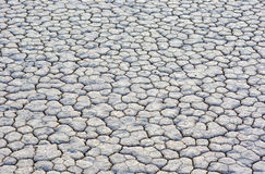 Closeup Of Dry and Cracked Mud Soil in Racetrack Playa in Death Royalty Free Stock Photo