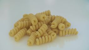 Closeup of dry maccheroni lying on the table. The frame rotates clockwise. Closeup of dry maccheroni lying on the table. The frame rotates clockwise stock video footage