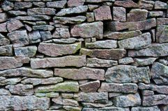 Closeup on a dry stone wall Royalty Free Stock Photography