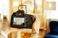 Closeup on DSLR camera in hand of female interior photographer stock photography
