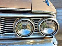 Closeup of dual headlights on a classic car stock photos