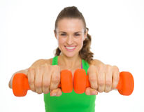 Closeup on dumbbells in hand of fitness young woman Royalty Free Stock Photography