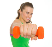 Closeup on dumbbells in hand of fitness young woman Royalty Free Stock Photo