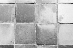 Closeup of a dusty paving from above. Close-up of a dusty and smooth paving viewed from above in black and white Stock Photography