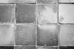 Closeup of a dusty paving from above. Close-up of a dusty and smooth paving viewed from above in black and white with vignetting Stock Photos