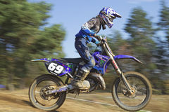 Closeup dynamic shot of motocross racer Stock Photo