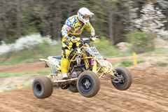 Closeup dynamic shot of quad rider in yellow Stock Images