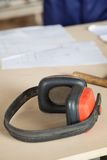 Closeup Of Ear Protectors On Wooden Table Stock Image