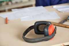 Closeup Of Ear Protectors On Wooden Table Royalty Free Stock Photo