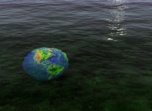 Global warming. Closeup of the Earth under water Stock Photography