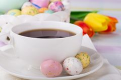 Closeup of a Cup of Coffee and Easter Candy Stock Image