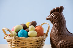 Closeup of easter chocolate chicken and eggs Stock Photos