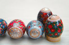 Closeup of easter egg on the table. Close-up of Easter egg with floral design. symbol of Christian faith and traditional cuisine Royalty Free Stock Photo