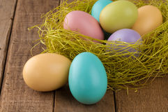 Closeup of Easter Eggs in Nest on Wood Stock Image