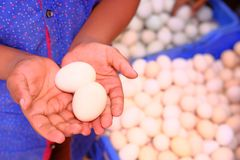 Closeup of eggs on hand at supermarket.  Royalty Free Stock Image