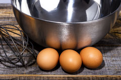 Closeup of eggs, whisk and bowl Stock Photo