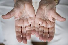 Closeup of elderly hand palms royalty free stock photos