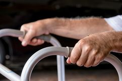 Elderly hands holding the walker. Closeup elderly hands holding the walker royalty free stock photos
