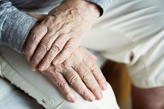Closeup of elderly hands putting together royalty free stock image