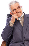 Closeup of an elderly man looking away in deep thought Royalty Free Stock Image