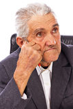 Closeup of an elderly man looking away in deep thought Stock Photo