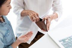Closeup elderly woman hands open wallet,grandmother or guardian giving pocket money to granddaughter,asian little girl demanding stock images