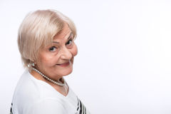 Closeup of elderly woman looking from behind Stock Photos