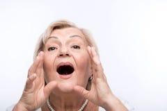 Closeup of elderly woman shouting royalty free stock photo