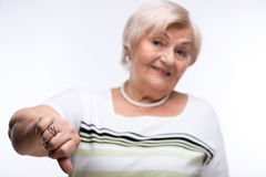 Closeup of elderly woman showing disapproval. Rejected. Cropped image of elderly woman shrugging her shoulders with clueless expression while standing against Royalty Free Stock Photo